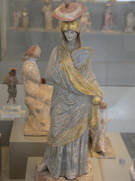 Statue of a Woman with Blue and Gilt Garment, Fan and Sun Hat, from Tanagra - Ancient Greek Painting
