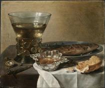 Still Life with Silver Brandy Bowl, Wine Glass, Herring and Bread - Pieter Claesz